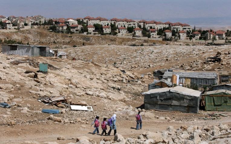 Palestinian Bedouin school children walk